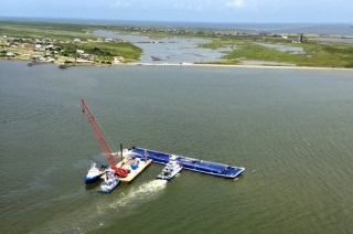 Recovery operations after a barge collision in the Houston Ship Channel in July 2015/ U.S. Coast Guard photo