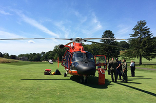 A USCG helicopter on the green at Staten Island's Richmond County Country Club. Photo: USCG
