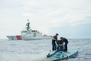 A USCG boarding team opens the bridge of a self-propelled semisubmersible interdicted off the coast of Central America on July 19. Coast Guard photo by Petty Officer 2nd Class LaNola Stone.