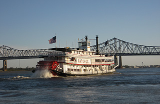 New Orleans Steamboat Companyu2019s Natchez on the Mississippi River. Creative Commons photo by Infrogmation.