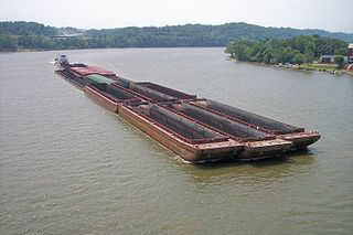 A coal barge on the Ohio River. Creative Commons photo/Tim Kiser.