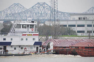 Covered hopper barges under tow. David Krapf photo.