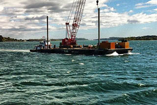 North Shore Marine's Emily Anne transporting a barge. North Shore Marine photo.