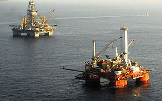 Oil rigs in the Gulf of Mexico. USCG photo.