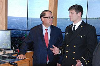 Morton S. Bouchard III with SUNY Maritime cadet Kelly Paseka on bridge of tug and barge simulator. Kirk Moore photo.