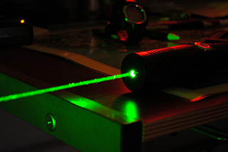 "A high-power green laser. Creative Commons photo by Andrew ""FastLizard4"" Adams."
