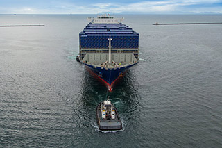 Tugs assist a containership at the Port of Long Beach. Port of Long Beach photo.