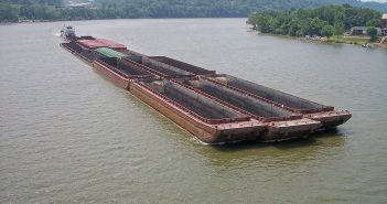 A coal barge tow moves down the Ohio River. Creative Commons photo by Tim Kiser.