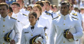 The 2016 graduating class of Kings Pointers stand during their graduation ceremony at the U.S. Merchant Marine Academy in Kings Point, New York, June 18. U.S. Army photo.