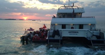 Guests from the Majesty wedding cruise gone awry are transferred to the ferry Asteria. Massachusetts Environmental Police photo.