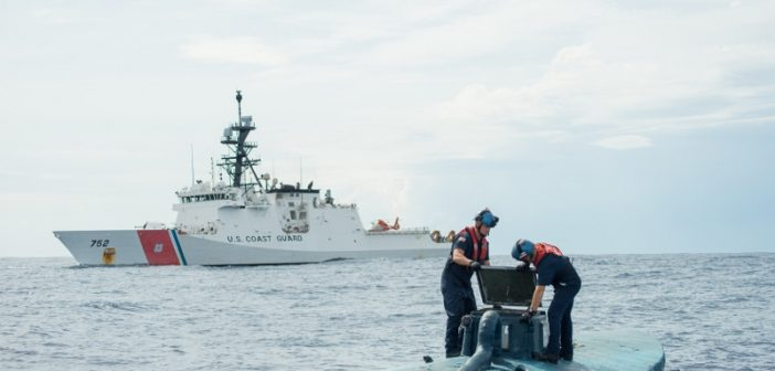 Crew from the Coast Guard cutter Stratton on a drug smugglers' semisubmersible boat captured in July 2015