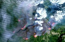 The major force boosting oil prices recently was the shut-in of 1 million barrels of oil sands output due to the Fort McMurray wildfires. A NASA Earth Observatory satellite image shows the burn scar left by the wildfire on May 4, 2016.