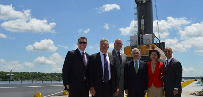 Officials pose before the Port of Providence's new crane barge, Sandy C. Marad photo.