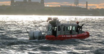 A 25' response boat from Coast Guard Station New York underway in New York Harbor at dusk. Analysis has found the USCG might save money in the long term converting to diesel outboards. USCG photo.