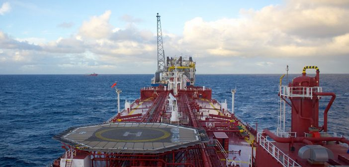 An oil tanker approaches a floating production, storage, and offloading vessel. Creative Commons photo by Jon Olav Eikenes.