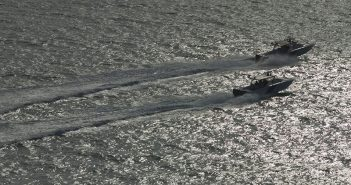 Two Customs and Border Protection Marine Unit vessels patrol the water off of the coast of South Florida near Miami. CBP photo by James Tourtellotte.