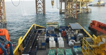 A PSV delivers equipment to an offshore drilling rig. Creative Commons photo by Ciacho5.