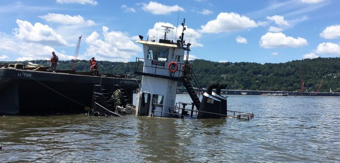 The pusher tug Potomac partially sunk at the Tappan Zee bridge construction site. Palisades Parkway Police photo