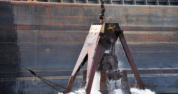 A dredge bucket removes material from the Arthur Kill Channel between New York and New Jersey during deepening operations in 2015. USACE photo.