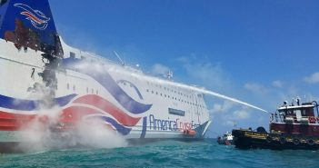 The tug Beth McAllister sprays water into the burning Caribbean Fantasy near San Juan, Puerto Rico, Aug. 17, 2016. Coast Guard photo