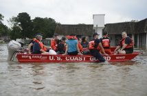 U.S. Coast Guard members rescue locals from flood water on their flat-bottom boats in Baton Rouge, La., Aug. 14, 2016. USCG photo.