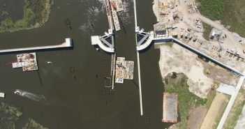 An aerial photograph of the Gulf Intracoastal Waterway (GIWW) sector gate and barge gate opening at the IHNC Surge Barrier. The GIWW is among the waterways on which vessel operators are required to pay fuel tax. USACE photo.