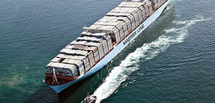 Tugs maneuver around a Maersk cargo ship. Maersk photo.