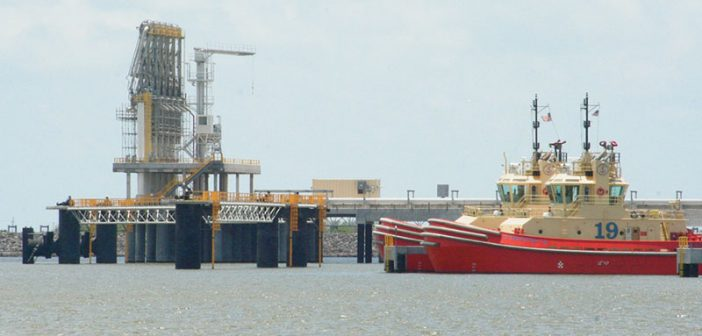 Chiksan arms and tugboats ready to assist inbound LNG tankers at Cheniere Energy's Sabine Pass terminal on the Texas-Louisiana border. Creative Commons photo by Roy Luck.