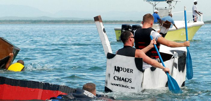 Participants cruise past the flotsam of fellow competitors during the annual U.S. Naval Station Guantanamo Great Cardboard Box Boat Regatta in 2008. U.S. Navy photo.
