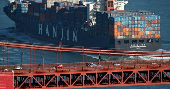 A Hanjin containership passes under the Golden Gate Bridge in San Francisco. Creative Commons photo by Basil D. Soufi.