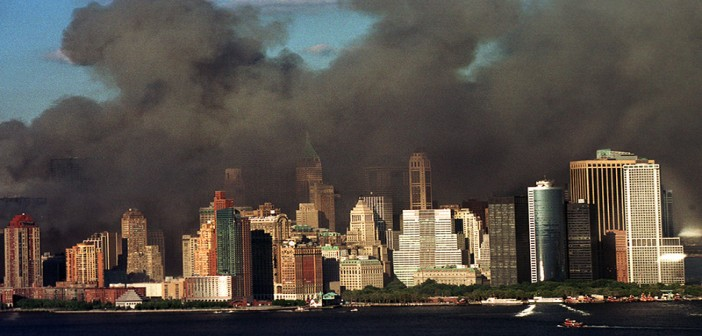 Workboats are visible lining the New York City waterfront on Sept. 11, 2001, as smoke from the fallen World Trade Center towers blackens the skyline. USCG Photo by Tom Sperduto.