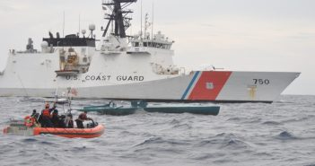 The Coast Guard Cutter Bertholf boarding team aboard an Over the Horizon Long-Range Interceptor boat approaches a self-propelled semi-submersible vessel suspected of smuggling 7.5 tons of cocaine in the Eastern Pacific Ocean, Aug. 31, 2015. The seized contraband is worth an estimated $227 million. (U.S. Coast Guard photo)