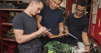 Sailors check the inventory of a chemical, biological, and radiological (CBR) monitoring kit in forward propulsion repair locker number four of the aircraft carrier Dwight D. Eisenhower. U.S. Navy photo.