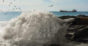 A dredge pumps sand ashore for beach replenishment. Great Lakes Dredge & Dock Company photo.