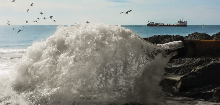 A dredge pumps sand ashore for beach replenishment. Great Lakes Dredge & Dock Company photo.
