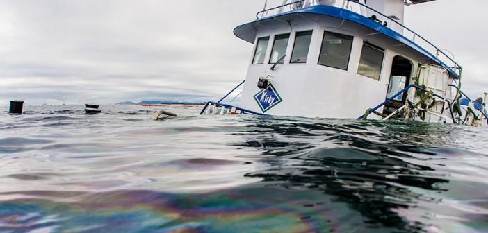 The Nathan E. Stewart lies partially submerged where it ran aground near Bella Bella, BC. Heiltsuk Nation photo by Tavish Campbell.