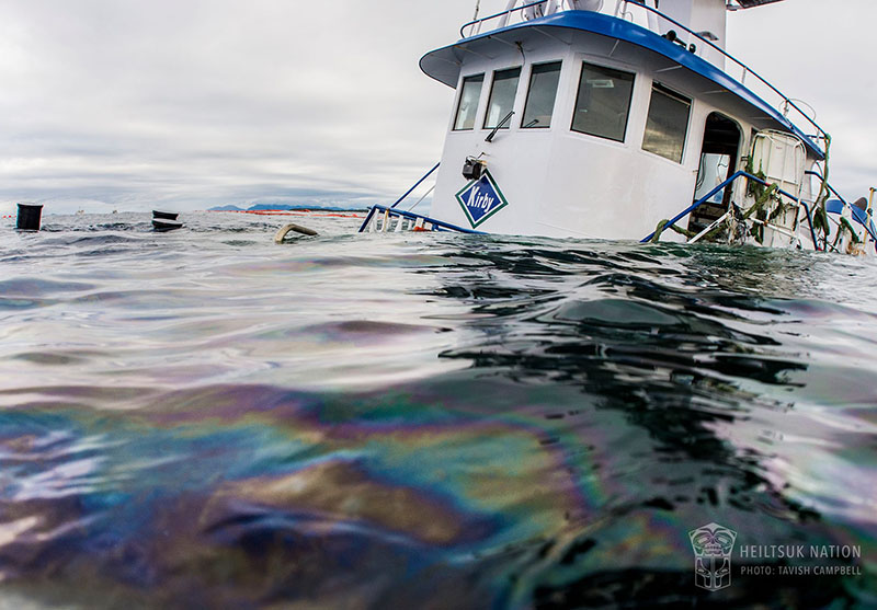 The Nathan E. Stewart lies partially submerged where it ran aground near Bella Bella, BC. Heiltsuk Nation photo by Tavish Campbell.
