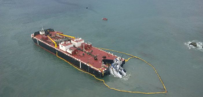 A containment boom around the sunken Nathan E Stewart. Western Canada Marine Response Corporation photo.