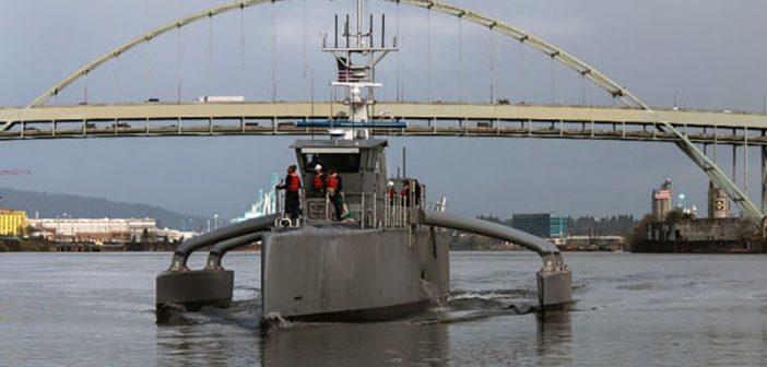 The Defense Advanced Research Projects Agency held a christening ceremony April 7 in Portland, Ore., for the Sea Hunter, the prototype vessel it designed, developed and built through its anti-submarine warfare continuous trail unmanned vessel program. DARPA photo.