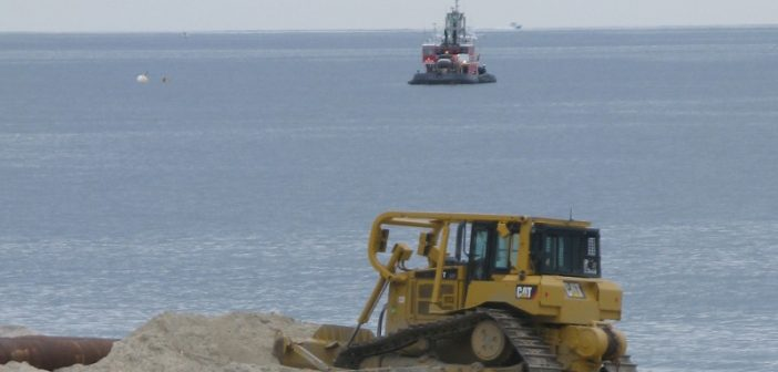 A bulldozer moves sand pumped from a dredge just offshore during a Corps of Engineers beach replenishment at Deal, N.J. in May 2015. Kirk Moore photo.