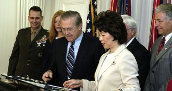 In 2003, then Secretary of Labor Elaine L. Chao stands beside then Defense Secretary Donald H. Rumsfeld to sign a memorandum of understanding designed to ease re-entry into the civilian workforce by military personnel. Department of Defense photo.