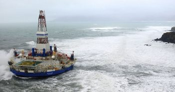 Royal Dutch Shell's conical drilling unit Kulluk sits aground on the southeast shore of Sitkalidak Island, Alaska on Jan. 1, 2013. USCG photo.