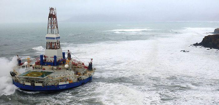 Royal Dutch Shell's conical drilling unit Kulluk sits aground on the southeast shore of Sitkalidak Island, Alaska on Jan. 1, 2013. USCG photo.