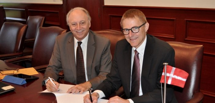 SUNY Maritime academic dean Gil Traub (left) and SIMAC vice president for academic affairs Jan Askholm sign the memorandum of agreement at SUNY Maritime College. SUNY Maritime photo.
