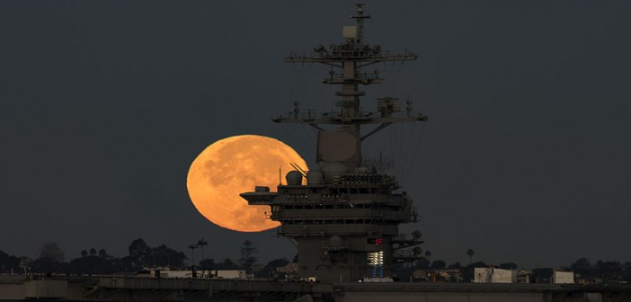 The supermoon sets behind the aircraft carrier USS Theodore Roosevelt on Nov. 14, 2016 in San Diego. U.S. Navy photo by Petty Officer 2nd Class Abe McNatt.