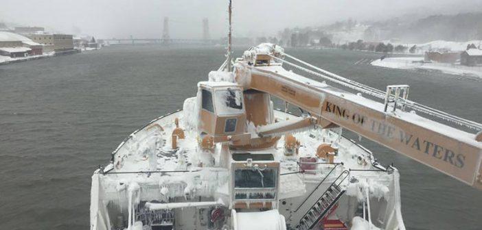 The Coast Guard Cutter Alder approaches the Portage Lake Lift Bridge in Houghton, Mich., Dec. 16, 2016. USCG photo.