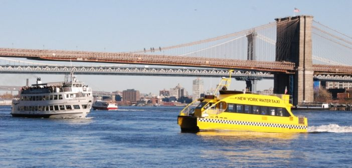 A New York Water Taxi ferry crossing the East River between Brooklyn and lower Manhattan. Kirk Moore photo.