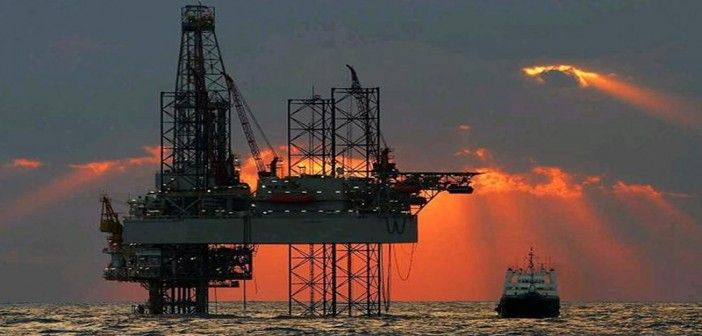 Sun filters down on a jack-up rig in the Gulf of Mexico. BOEM photo.