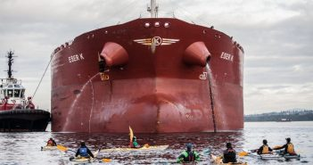 Activists in kayaks attempt to block the tanker Eser K from docking at the Kinder Morgan Westridge Marine terminal at Burrard Inlet, B.C., during protests in May 2016.