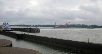 Inspection team members look on as a workboat crew at Locks and Dam 52 lowers the wicket dam in 2015. USACE photo.